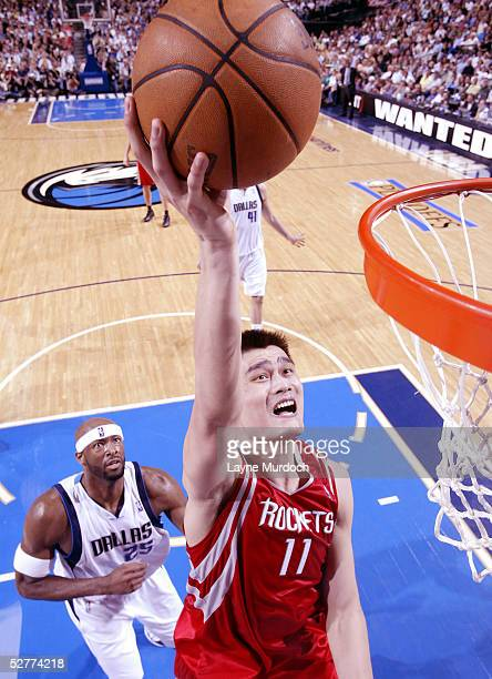 Yao Ming of the Houston Rockets dunks the ball over Erick Dampier of the Dallas Mavericks in Game seven of the Western Conference Quarterfinals...