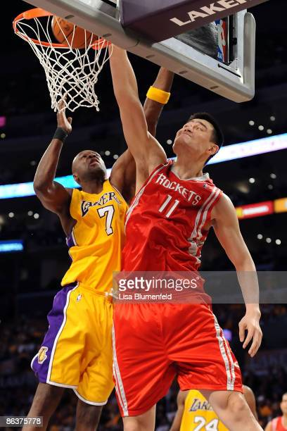 Yao Ming of the Houston Rockets dunks the ball over Lamar Odom of the Los Angeles Lakers in the first half in Game One of the Western Conference...