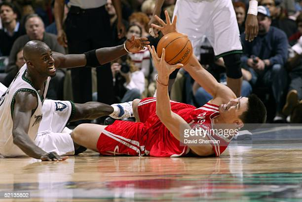 Yao Ming of the Houston Rockets fights for the ball with Kevin Garnett of the Minnesota Timberwolves on February 4 2005 at the Target Center in...