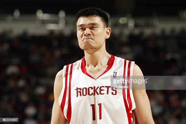 Yao Ming of the Houston Rockets frowns during the game against the Portland Trail Blazers at the Toyota Center on February 11 2008 in Houston Texas...