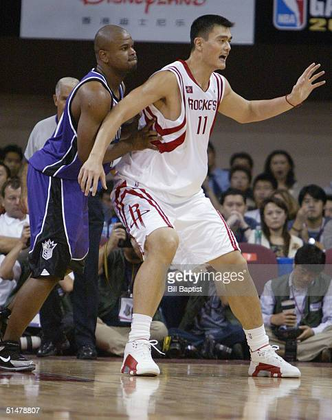 Yao Ming of the Houston Rockets goes up against Alton Ford of the Sacramento Kingsat the preseason NBA China game between the Sacramento Kings and...