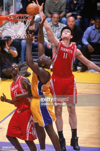 Yao Ming of the Houston Rockets goes up to block a shot by Shaquille O'Neal of the Los Angeles Lakers in Game One of the Western Conference...