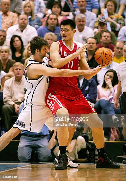 Yao Ming of the Houston Rockets is guarded by Mehmet Okur of the Utah Jazz in Game Three of the Western Conference Quarterfinals during the 2007 NBA...