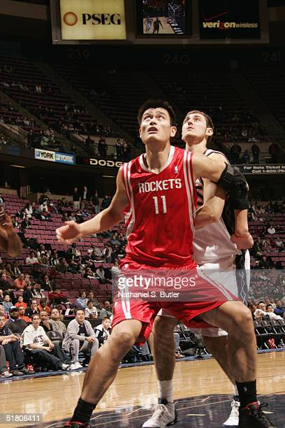 Yao Ming of the Houston Rockets looks for a rebound during the game against the New Jersey Nets on November 15 2004 at the Continental Airlines Arena...