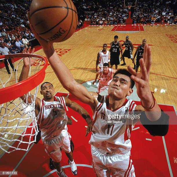 Yao Ming of the Houston Rockets makes a rebound against the San Antonio Spurs at Toyota Center on December 9 2004 in Houston Rockets The Rockets won...