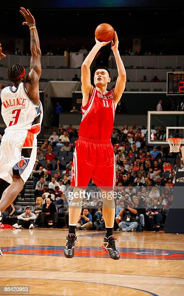 Yao Ming of the Houston Rockets makes first 3pointer in 6 years against Gerald Wallace of the Charlotte Bobcats on March 13 2009 at the Time Warner...