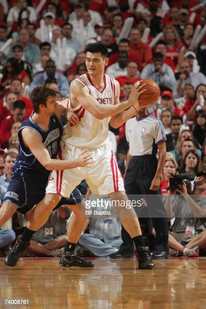 Yao Ming of the Houston Rockets prepares to make a move against Mehmet Okur of the Utah Jazz battle for a loose ball in Game Two of the Western...