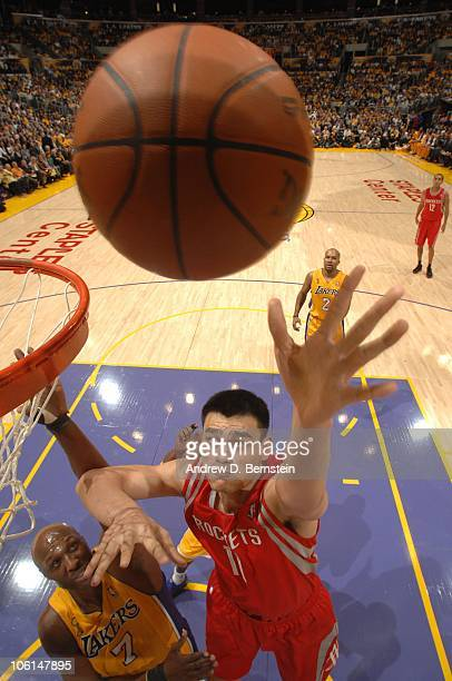 Yao Ming of the Houston Rockets puts up a shot against Lamar Odom of the Los Angeles Lakers at Staples Center on October 26 2010 in Los Angeles...