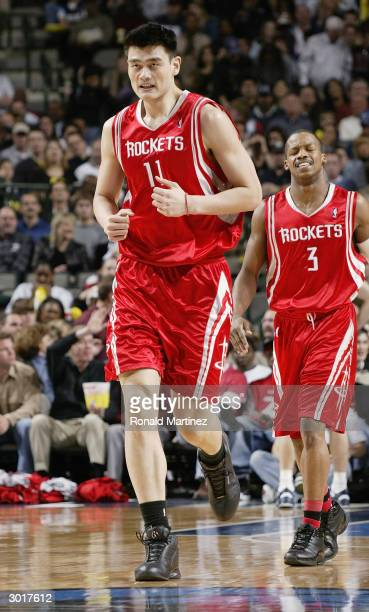 Yao Ming of the Houston Rockets runs up the court during the game against the Dallas Mavericks on February 21 2004 at American Airlines Center in...