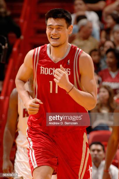 Yao Ming of the Houston Rockets runs upcourt during the game against the Miami Heat at American Airlines Arena on November 10 2005 in Miami Florida...
