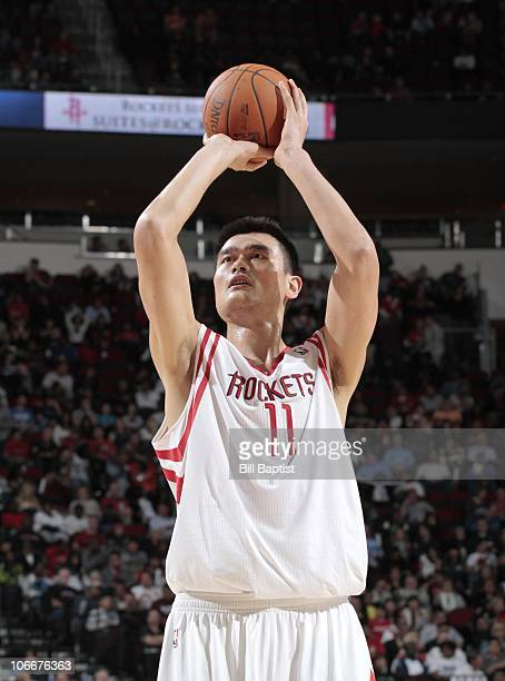 Yao Ming of the Houston Rockets shoots a free throw during a game against the New Orleans Hornets on November 3 2010 at the Toyota Center in Houston...