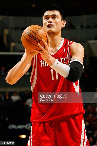 Yao Ming of the Houston Rockets shoots a free throw during the game against the Charlotte Bobcats on November 11 2007 at Charlotte Bobcats Arena in...