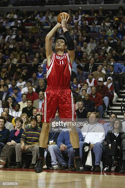Yao Ming of the Houston Rockets shoots a jump shot against the Detroit Pistons during the game at The Palace of Auburn Hills on November 2 2004 in...