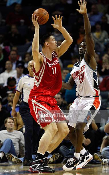 Yao Ming of the Houston Rockets shoots over Emeka Okafor of the Charlotte Bobcats during their game at Time Warner Cable Arena on March 13 2009 in...