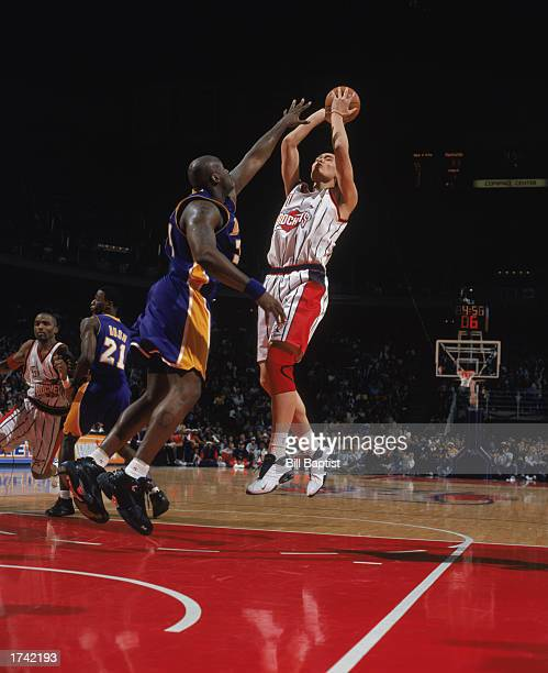 Yao Ming of the Houston Rockets shoots over Shaquille O'Neal of the Los Angeles Lakers at Compaq Center on January 17 2003 in HoustonTexas The...