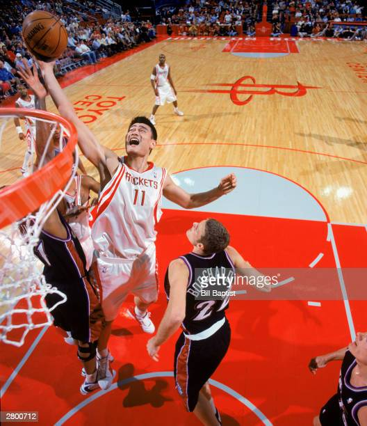 Yao Ming of the Houston Rockets takes the ball up against the Utah Jazz during the NBA game at Toyota Center on December 3 2003 Houston Texas The...