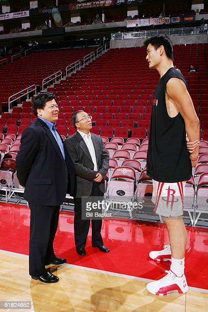 Yao Ming of the Houston Rockets talks to Dai Bingguo China's vice foreign minister and Yang Jiechi Chineese ambassador to the United States prior to...
