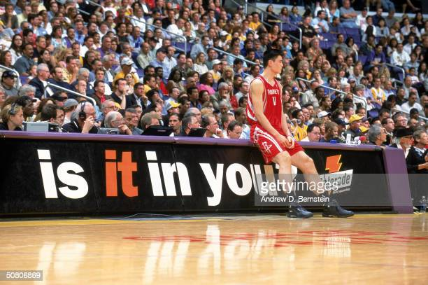 Yao Ming of the Houston Rockets waits to get into Game five of the Western Conference Quarterfinals during the 2004 NBA Playoffs against the Los...