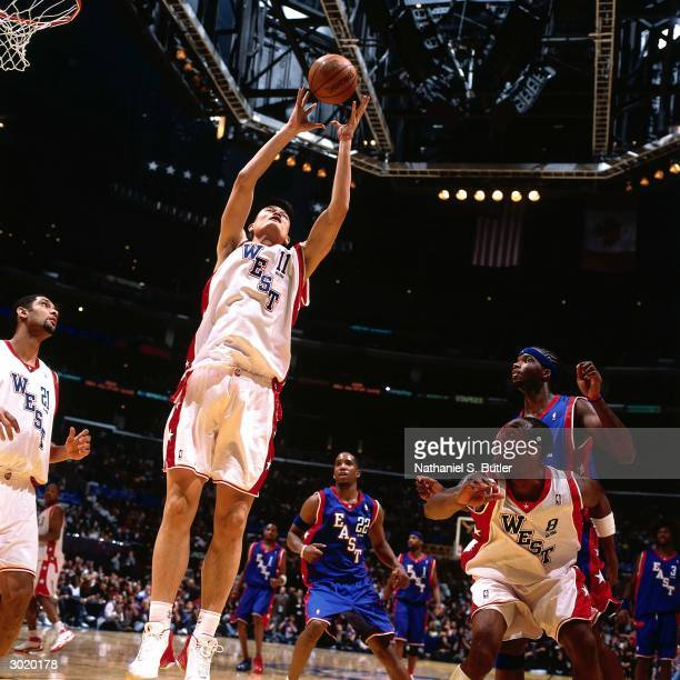 Yao Ming of the Western Conference AllStars rebounds against the Eastern Conference AllStars during the 2004 AllStar Game on February 15 2004 at...