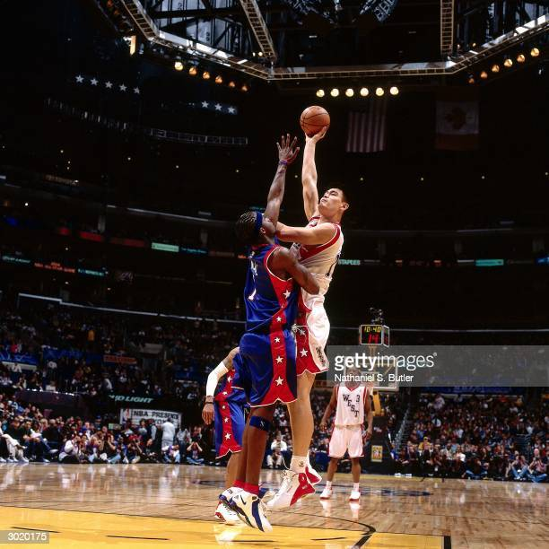 Yao Ming of the Western Conference AllStars shoots against Jermaine O'Neal of the Eastern Conference AllStars during the 2004 AllStar Game on...