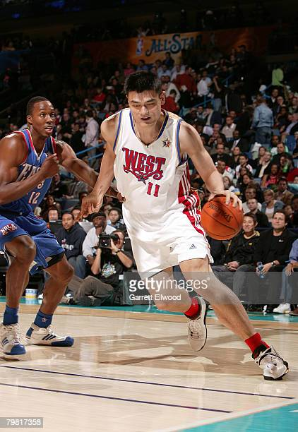 Yao Ming of the Western Conference drives on Dwight Howard of the Eastern Conference during the 2008 NBA AllStar Game part of 2008 NBA AllStar...
