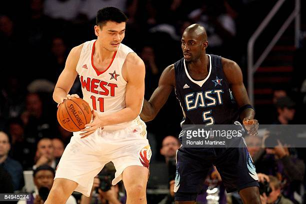 Yao Ming of the Western Conference goes up against Kevin Garnett of the Eastern Conference during the 58th NBA AllStar Game part of 2009 NBA AllStar...