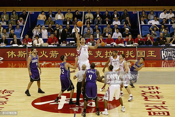 Yao Ming on the Houston Rockets gets the tipoff during the preseason NBA China game between the Sacramento Kings and the Houston Rockets on October...