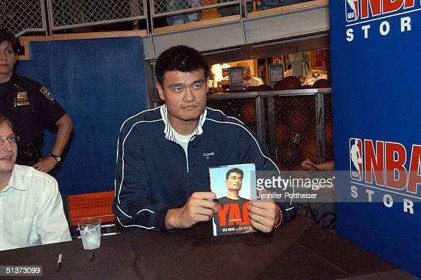 Yao Ming poses with his new book at a book signing at the NBA Store on September 29 2004 in New York City NOTE TO USER User expressly acknowledges...