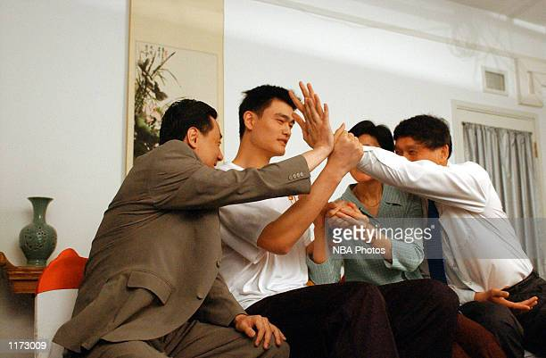 Yao Ming reacts after being chosen first overall in the 2002 NBA Draft on June25 2002 by the Houston Rockets Shanghai China NOTE TO USER User...