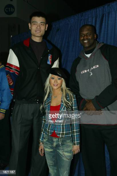 Yao Ming Shaquille O'Neal and headliner Christina Aguilera socialize during the NBA AllStar Read To Achieve Celebration part of the 2003 NBA AllStar...