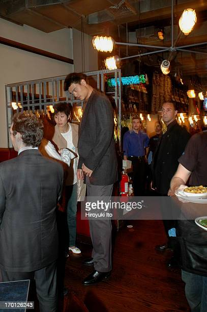 Yao Ming the NBA star from China dining at Blue Smoke on East 27th Street on Tuesday night September 28 2004He is with his girlfriend Ye Li