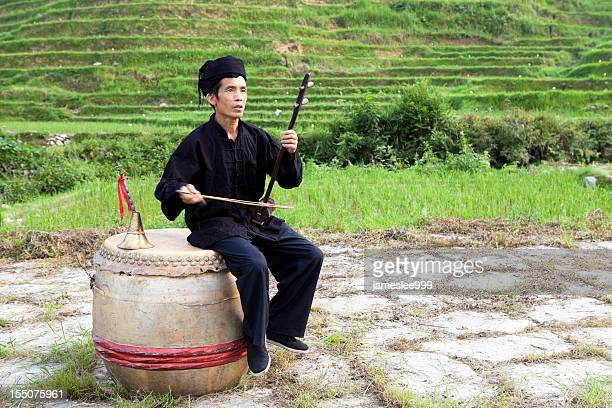 yao tribe farmer play erhu - traditional musician stock photos and pictures