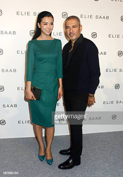 Yao Xing Tong and Eliie Saab attend the Elie Saab show as part of the Paris Fashion Week Womenswear Spring/Summer 2014 at the Espace Ephemere des...