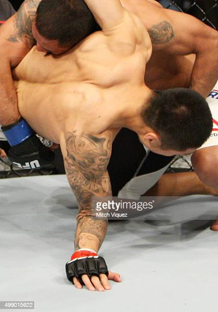 Yao Zhikui of China breaks his arm after a takedown by Fredy Serrano of Colombia in their flyweight bout during the UFC Fight Night at the Olympic...
