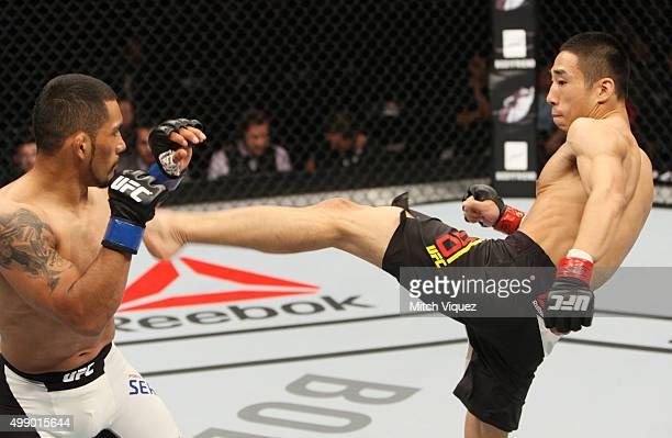 Yao Zhikui of China throws a kick at Fredy Serrano of Colombia in their flyweight bout during the UFC Fight Night at the Olympic Park Gymnastics...