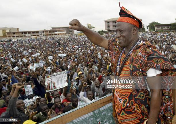 This file picture dated 10 October 2004 shows John Fru Ndi opposition party candidate for the Social Democratic front waving to supporters at a...
