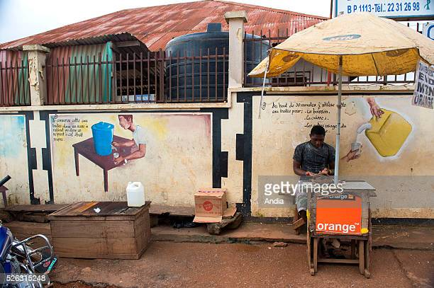 Street scene. Wall painting about water drinkability. .