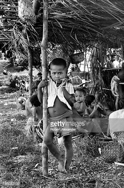 Yapese boy watches a Yap Day ceremony on Yap island in Micronesia a group of islands in the Western Pacific Ocean 5104602RA_Micronesia06jpg