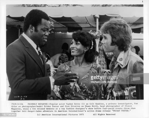 Yaphet Kotto and Pam Grier in a scene from the film 'Friday Foster' 1975