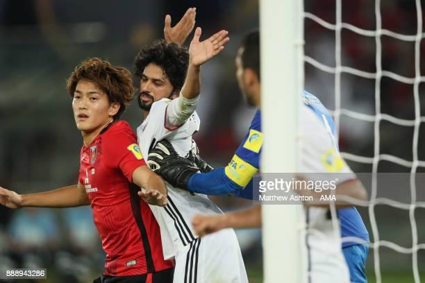 Yaqoub Al Hosani of Al Jazira pays close attention to Toshiyuki Takagi of Urawa Red Diamonds during the FIFA Club World Cup UAE 2017 match between Al...