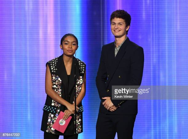 Yara Shahidi and Ansel Elgort speak onstage during the 2017 American Music Awards at Microsoft Theater on November 19 2017 in Los Angeles California