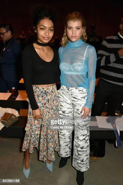 Yara Shahidi and Sofia Richie attend Topshop's London Fashion Week show at Tate Modern on February 19 2017 in London England