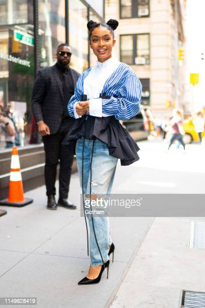 Yara Shahidi is seen wearing a Sacai top with Amiri jeans and Brian Atwood shoes attending AOL Build in NoHo on May 16, 2019 in New York City.