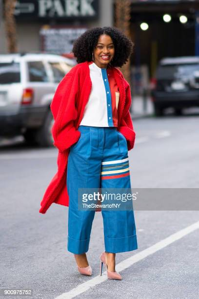 Yara Shahidi is seen wearing Thom Browne shirt and pants with an Opening Ceremony coat Loriblu shoe Lady Grey/Sarah Magid earrings and Paige Novick...