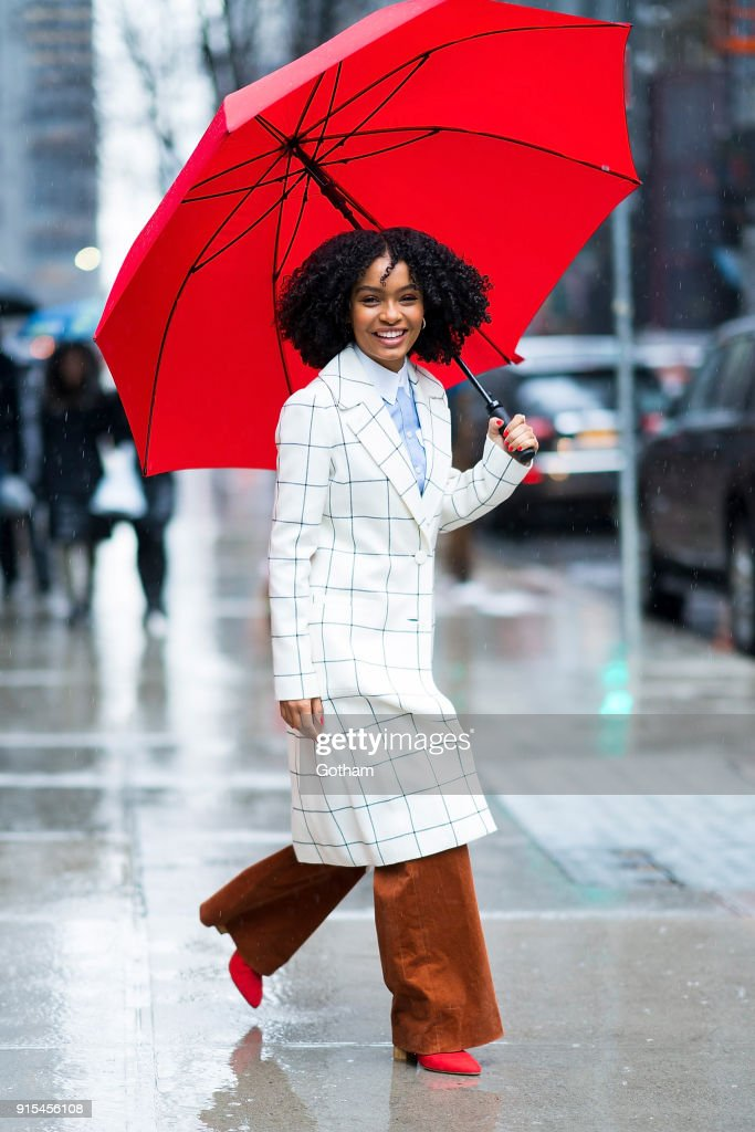 Yara Shahidi is seen wearing Tory Burch coat, button-down and trousers with Phillip Lim 3.1 mules and David Yurman jewelry in Midtown on February 7, 2018 in New York City.