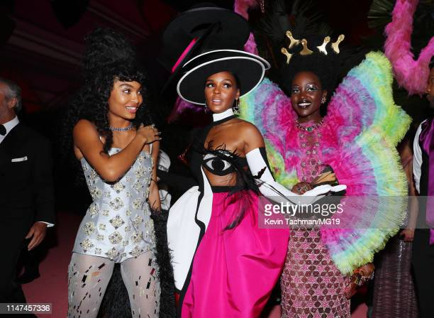 Yara Shahidi Janelle Monáe and Lupita Nyong'o attend The 2019 Met Gala Celebrating Camp Notes on Fashion at Metropolitan Museum of Art on May 06 2019...