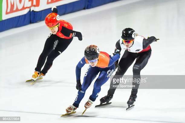 Yara Van Kerkhof Natalia Maliszewska and Lang A Kim skate in a pack during the preliminary 500m heat at the ISU World Short Track Speed Skating...