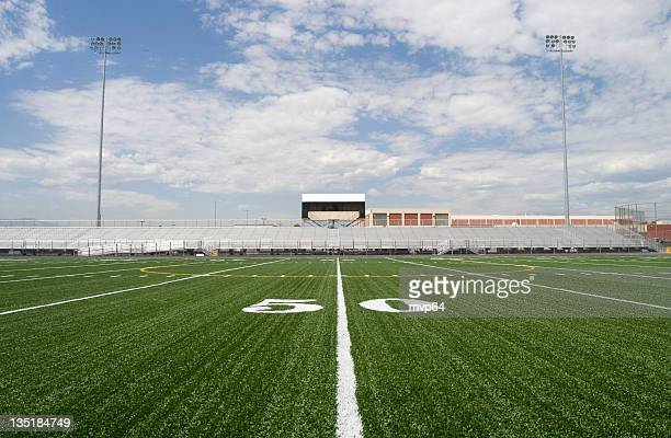 50 yard line in a football stadium - american football pitch stock pictures, royalty-free photos & images