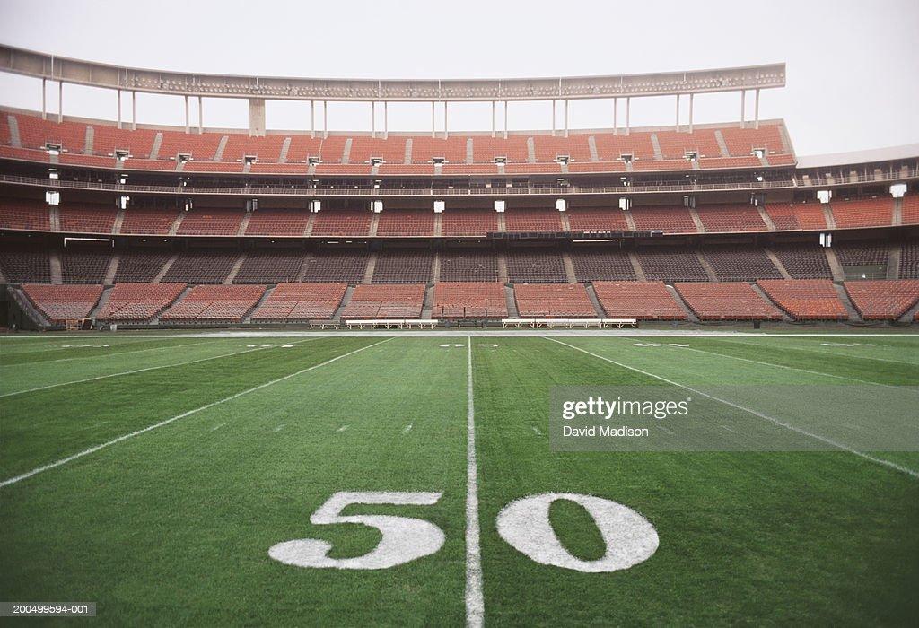 50 yard line on american football field closeup stock