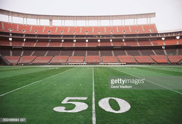 50 yard line on american football field, close-up - football field stock pictures, royalty-free photos & images